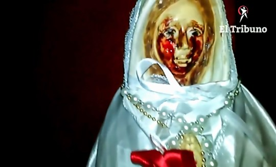 """Pic Shows: The virgin cries blood; This is the moment an eyewitness filmed a statue of the Virgin Mary apparently weeping tears of blood. People have been flocking to the town of San Jose de Metan, in the north-western Argentinian province of Salta, to see the phenomenon. But it has now been caught on camera for the first time after a visitor with a smartphone filmed the alleged """"miracle"""". The footage shows the face of the statue with a blood red liquid running down both cheeks. The small gold-painted plaster statue, known as the Virgin of the Mystic Rose, was originally located in a home in the small town but has been moved to the church. Owner Frias Mendoza says he has witnessed tears - sometimes made of crystals, others a blood-like red liquid - on the face of the statue several times in the last year. And Mr Mendoza claims that he was visited in a dream by the Virgin Mary the night before he first witnessed the """"miracle"""". He said: """"I thought it was some kind of punishment and was scared."""" The 50 cm (20 ins) high statue was moved to the local church after the family started receiving so many visitors that their living room had become a shrine. Local people have been divided over the claims. Some say the Virgin is crying over government proposals to liberalise Argentina???s strict abortion laws. But others are not convinced. One sceptical online commentator joked: """"The local parish priest must have done a degree in marketing."""" Weeping virgins have been a phenomenon around the world for many years. Recently in the US state of New Mexico, a seven foot bronze statue of the Virgin was said to have wept tears of olive oil. The church says it always looks for a scientific explanation before a supernatural one. So far in San Jose de Metas no scientific explanation has been forthcoming."""