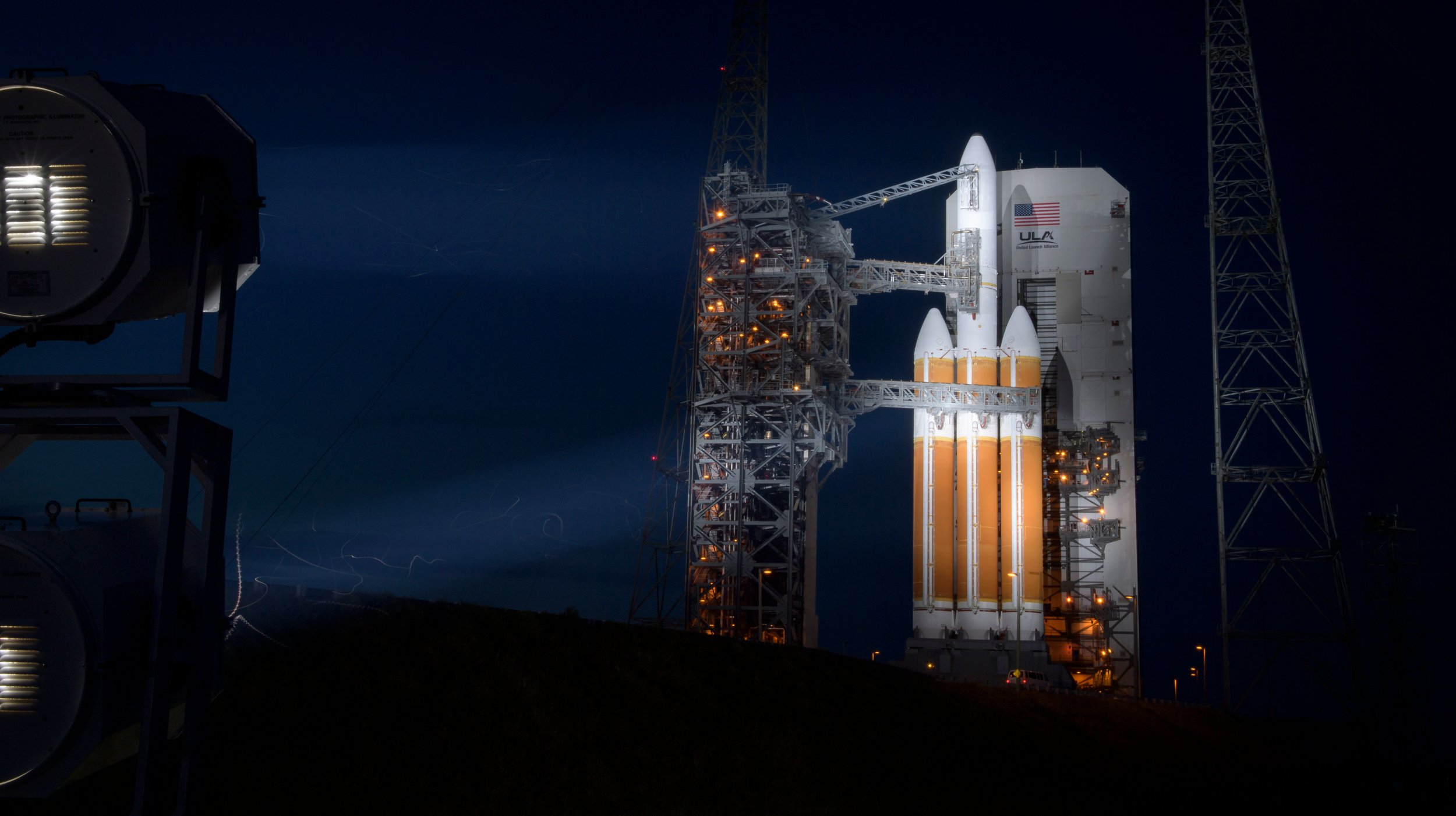 """This handout photo released by NASA shows the United Launch Alliance Delta IV Heavy rocket with the Parker Solar Probe onboard shortly after the Mobile Service Tower was rolled back on August 10, 2018, Launch Complex 37 at Cape Canaveral Air Force Station in Florida. - NASA counted down on August 10 to the launch of a $1.5 billion spacecraft that aims to plunge into the Sun's sizzling atmosphere and become humanity's first mission to explore a star. The car-sized Parker Solar Probe is scheduled to blast off on a Delta IV Heavy rocket from Cape Canaveral, Florida early on August 11. (Photo by Bill INGALLS / NASA / AFP) / RESTRICTED TO EDITORIAL USE - MANDATORY CREDIT """"AFP PHOTO / NASA / BILL INGALLS """" - NO MARKETING NO ADVERTISING CAMPAIGNS - DISTRIBUTED AS A SERVICE TO CLIENTSBILL INGALLS/AFP/Getty Images"""