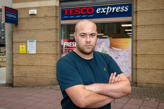 Matthew Brackley age 27 outside the Tesco in Cambridge where he had an altercation with the security guard. See Masons copy MNTESCO:A Tesco customer claims he was forced out of a store and verbally assaulted by a security guard because he was 'too fat'.Matthew Brackley, claims he went to Tesco Express to get an ice cream with his shirt off due to the scorching weather conditions.He claims the security guard walked over to him, while Matthew was 'minding his own business' and began to shout at him.