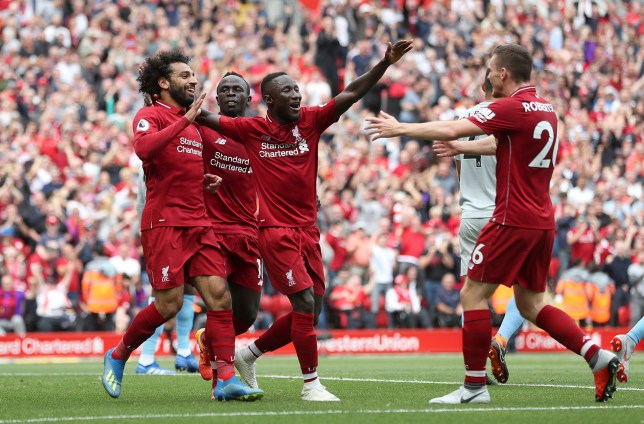 """Liverpool's Mohamed Salah (left) celebrates scoring his side's first goal of the game with Naby Keita during the Premier League match at Anfield, Liverpool. PRESS ASSOCIATION Photo. Picture date: Sunday August 12, 2018. See PA story SOCCER Liverpool. Photo credit should read: David Davies/PA Wire. RESTRICTIONS: EDITORIAL USE ONLY No use with unauthorised audio, video, data, fixture lists, club/league logos or """"live"""" services. Online in-match use limited to 120 images, no video emulation. No use in betting, games or single club/league/player publications."""