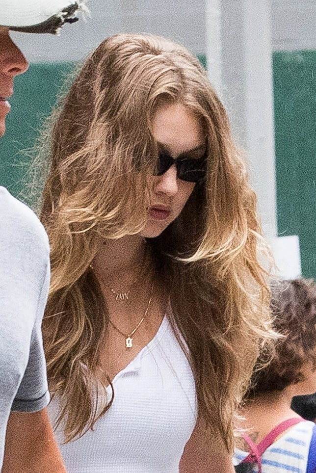 ** RIGHTS: WORLDWIDE EXCEPT IN BELGIUM, FRANCE, GERMANY, NETHERLANDS, POLAND ** New York, NY - Model Gigi Hadid wears Zayn's necklace and carries a Unicef backpack as she goes into Zayn's apartment in Soho this afternoon. Pictured: Gigi Hadid BACKGRID USA 14 AUGUST 2018 BYLINE MUST READ: Skyler2018 / BACKGRID USA: +1 310 798 9111 / usasales@backgrid.com UK: +44 208 344 2007 / uksales@backgrid.com *UK Clients - Pictures Containing Children Please Pixelate Face Prior To Publication*