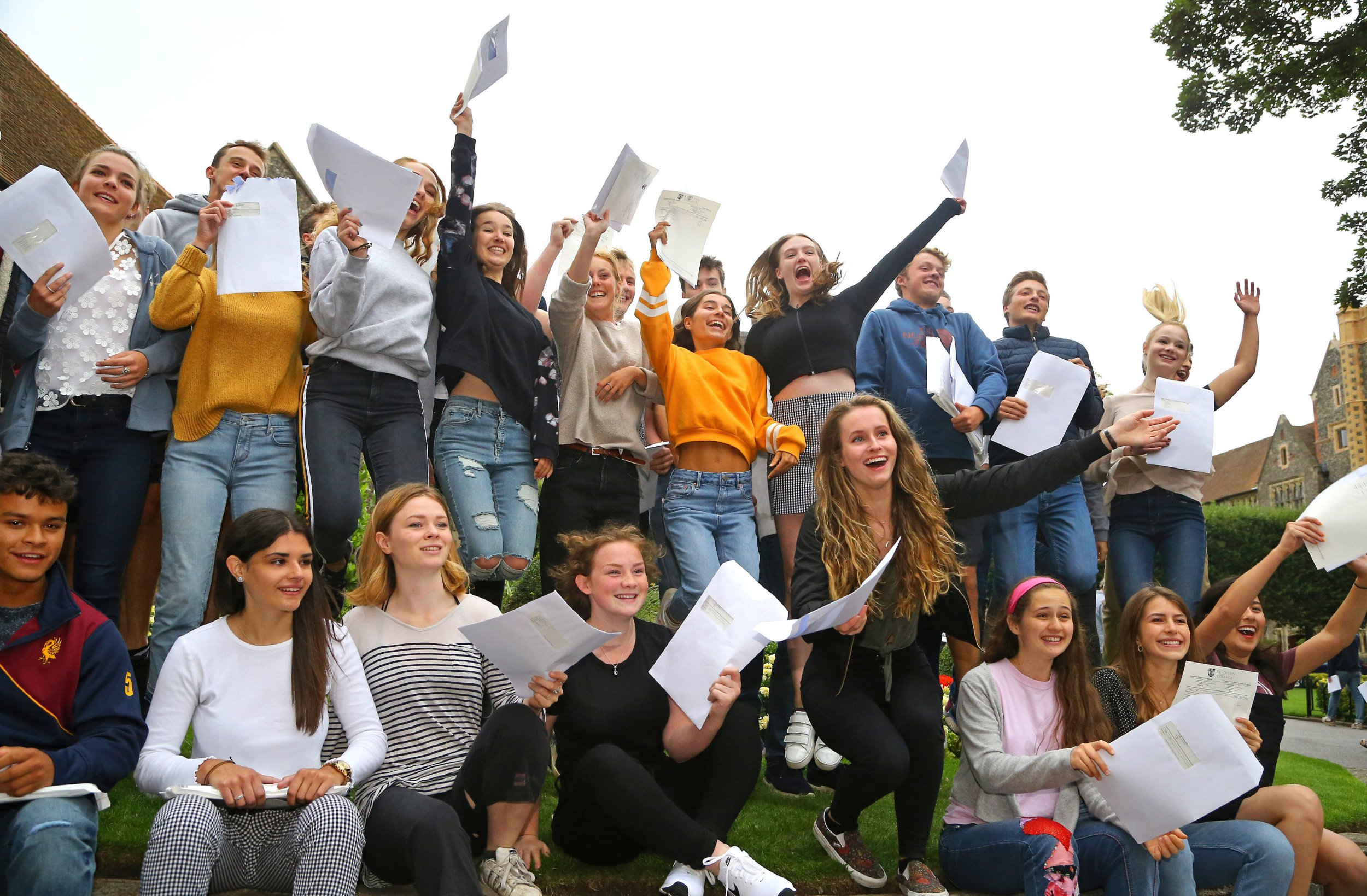 Students celebrate their A Level results at Brighton College in East Sussex. PRESS ASSOCIATION Photo. Picture date: Thursday August 16, 2018. See PA story EDUCATION Alevels. Photo credit should read: Gareth Fuller/PA Wire