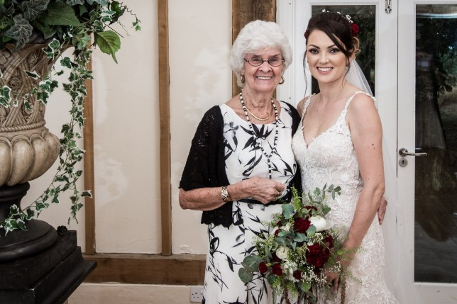 MERCURY PRESS. 16/08/18. Pictured: Shirley Moodie, 83, was her granddaughter Leanne McQuillains bridesmaid. A bride has chosen her overjoyed nan to be her bridesmaid - to make as many happy memories as possible before the 83 year olds Alzheimers worsens. When Leanne McQuillan, 35, got engaged to her partner of 10 years Wayne McQuillain, 39, she instantly approached her nan Shirley Moodie - as the pensioner had always joked about being a bridesmaid. Parents-of-three Leanne and Wayne tied the knot in a gorgeous ceremony at Vaulty Manor in the rural village of Goldhanger, Essex, on August 9. Grandmother-of-16 Shirley was so excited on the day that she walked down the aisle in her beautiful white and black gown, laughing and bopping family members on their heads with her bouquet. SEE MERCURY COPY