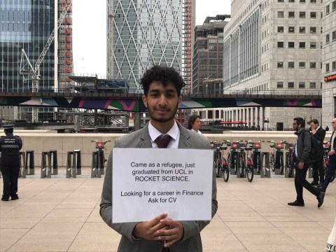 Refugee rocket scientist stands outside Canary Wharf asking for a job
