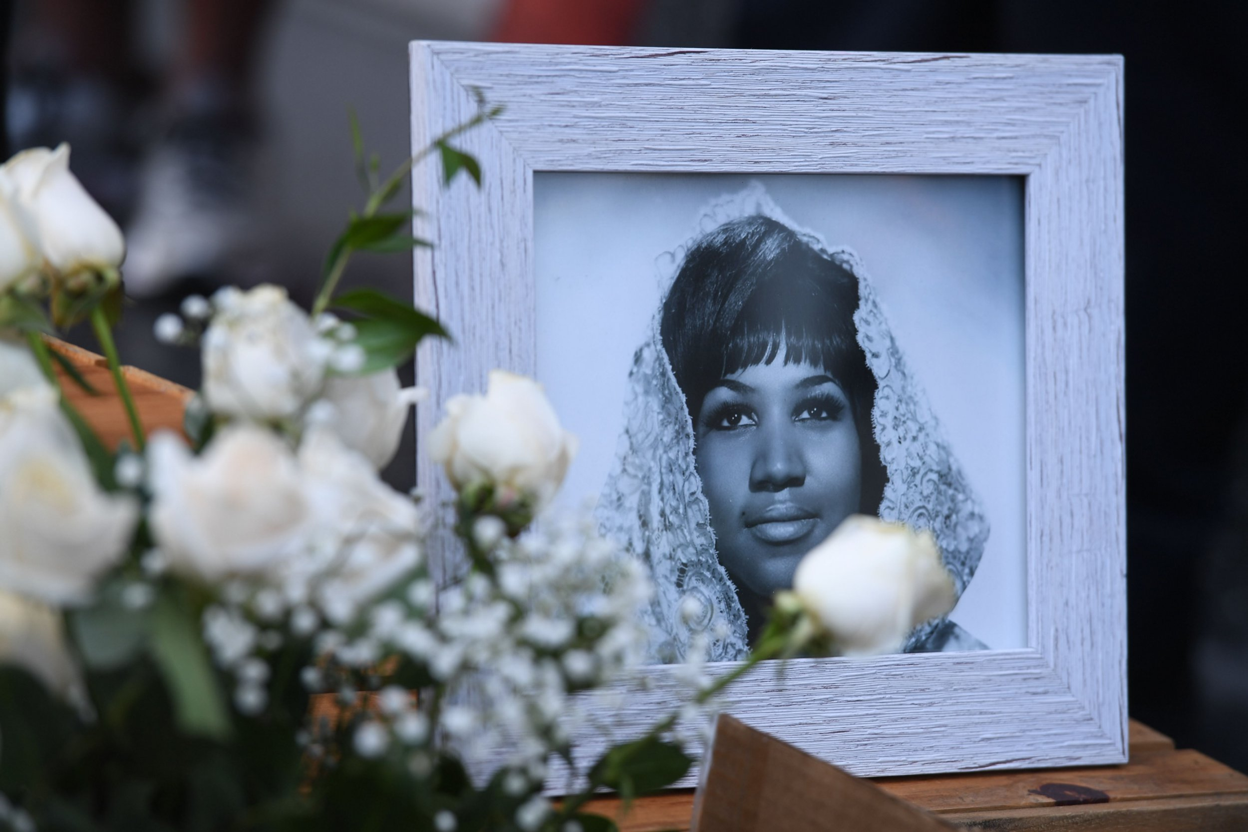 """Flowers and tributes are placed on the Star for Aretha Franklin on the Hollywood Walk of Fame in Hollywood, California, August 16, 2018, following the death of music icon, legendary singer and """"Queen of Soul"""" loved by millions whose history-making career spanned six decades. - Franklin, who died at age 76 on August 16, 2018, influenced generations of female singers with unforgettable hits including """"Respect"""" (1967), """"Natural Woman"""" (1968) and """"I Say a Little Prayer"""" (1968). She passed away at home in Detroit from advanced pancreatic cancer. (Photo by Mark RALSTON / AFP)MARK RALSTON/AFP/Getty Images"""