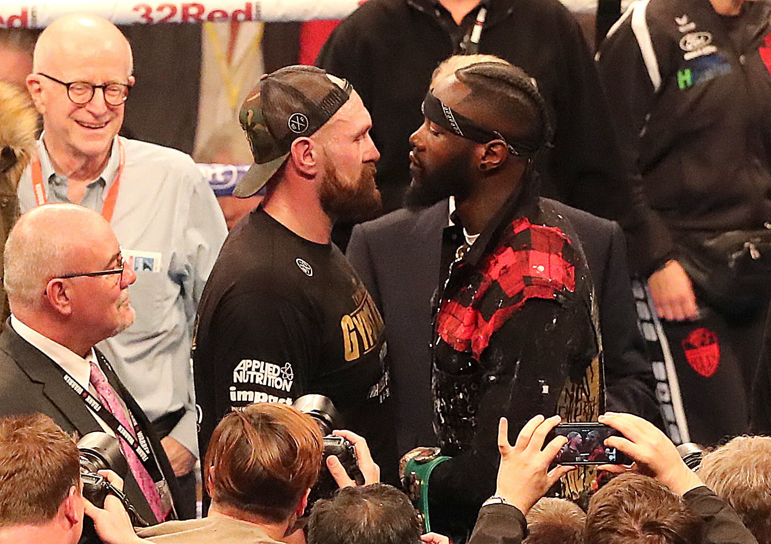 Tyson Fury and WBC heavyweight champion Deontay Wilder at Windsor Park, Belfast. PRESS ASSOCIATION Photo. Picture date: Saturday August 18, 2018. See PA story BOXING Belfast. Photo credit should read: Niall Carson/PA Wire