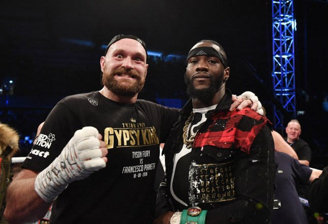 BELFAST, NORTHERN IRELAND - AUGUST 18: Tyson Fury poses with rival boxer Deontay Wilder after defeating Francesco Pianeta in a heavyweight contest at Windsor Park on August 18, 2018 in Belfast, Northern Ireland. (Photo by Charles McQuillan/Getty Images)