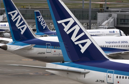 All Nippon Airways Co. (ANA) aircraft stand parked at Haneda Airport in Tokyo, Japan, on Wednesday, April 26, 2017. ANA is scheduled to release Fourth-quarter earnings figures on April 28. Photographer: Tomohiro Ohsumi/Bloomberg via Getty Images