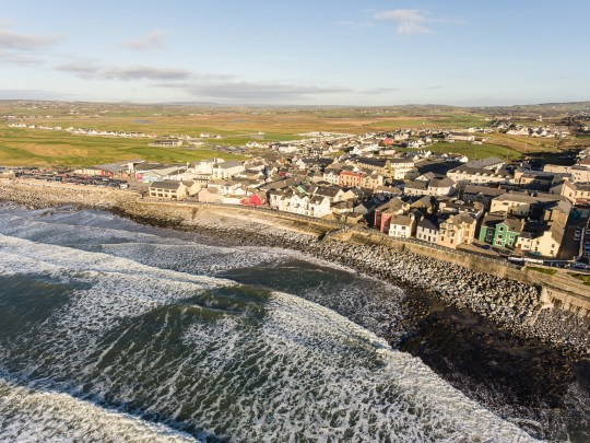 Aerial view of Ireland's top surfing town and beach in Ireland. Lahinch Lehinch town and beach in county clare. Beautiful scenic rural countryside in ireland.; Shutterstock ID 553074685; Purchase Order: -