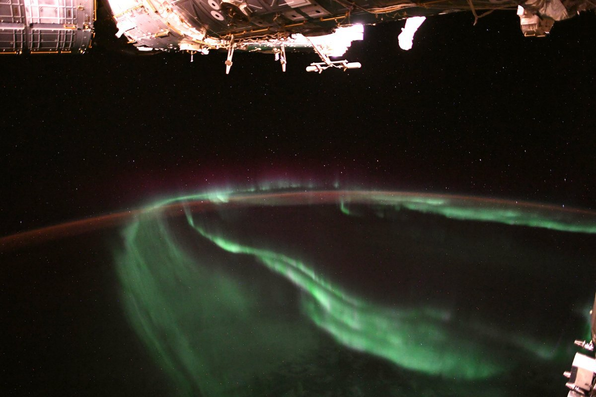 """Ever wondered what auroras look like from space? Astronaut Alexander Gerst, also known as @Astro_Alex, gives us his bird's-eye view from aboard the International Space Station, tweeting that the experience is """"[m]ind-blowing, every single time."""" The dancing lights of the auroras provide spectacular views on the ground and from space, but also capture the imagination of scientists who study incoming energy and particles from the Sun. Auroras are one effect of such energetic particles, which can speed out from the sun both in a steady stream called the solar wind and due to giant eruptions known as coronal mass ejections. After a trip toward Earth that can last 2 or 3 days, the solar particles and magnetic fields cause the release of particles already trapped near Earth, which in turn trigger reactions in the upper atmosphere in which oxygen and nitrogen molecules release photons of light. The result: the Northern and Southern lights. Image Credit: ESA/NASA-A.Gerst"""