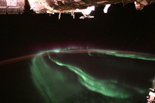 "Ever wondered what auroras look like from space? Astronaut Alexander Gerst, also known as @Astro_Alex, gives us his bird's-eye view from aboard the International Space Station, tweeting that the experience is ""[m]ind-blowing, every single time."" The dancing lights of the auroras provide spectacular views on the ground and from space, but also capture the imagination of scientists who study incoming energy and particles from the Sun. Auroras are one effect of such energetic particles, which can speed out from the sun both in a steady stream called the solar wind and due to giant eruptions known as coronal mass ejections. After a trip toward Earth that can last 2 or 3 days, the solar particles and magnetic fields cause the release of particles already trapped near Earth, which in turn trigger reactions in the upper atmosphere in which oxygen and nitrogen molecules release photons of light. The result: the Northern and Southern lights. Image Credit: ESA/NASA-A.Gerst"