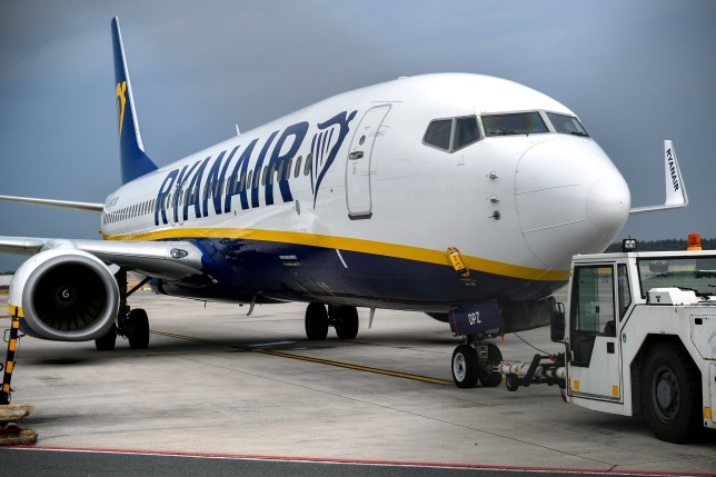epa06966006 (FILE) - A Ryanair airplane stands on the tarmac at the Niederrhein airport in Weeze, Germany, 09 August 2018 (reissued 23 August 2018). Ryanair and Irish trade union Forsa have reached an agreement on 23 August 2018, in the pilots' dispute following a 22-hour negotiating session. The long-running dispute between the low-cost airline and its Irish pilots over pay, base transfers, annual leave, conditions and other issues, caused cancelled flights through Europe. EPA/SASCHA STEINBACH