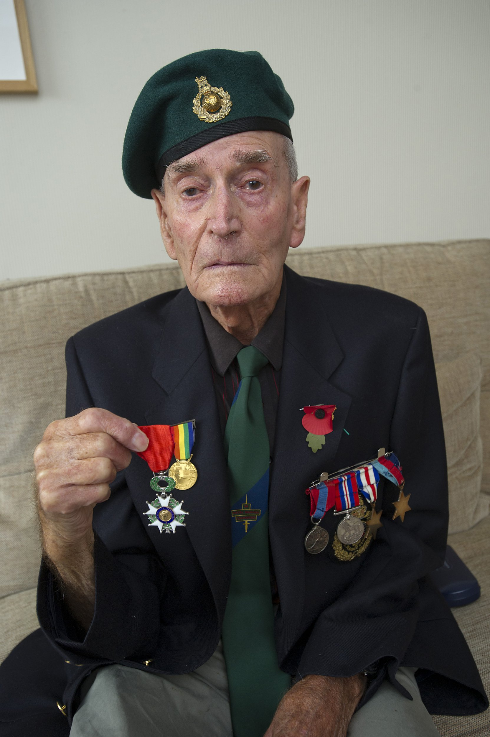 Copyright Pic by Andrew Price/View Finder Pictures-Chester 07774611778 PLEASE DO NOT USE ONLINE UNTIL MIDNIGHT ON THE 23RD. Picture taken 230818. Caption: Former Royal Marrine Commando Eric Vaughan with his medals. While Eric was on holiday visiting the battlefields for the first time since 1944 a neighbour rang and said his home was being burgled. When he returned home he found that they had taken his wartime souvenirs, including two watches and money from the time including a Nazi Reichmark.??? See story from Glyn Bellis on 07836 553901.