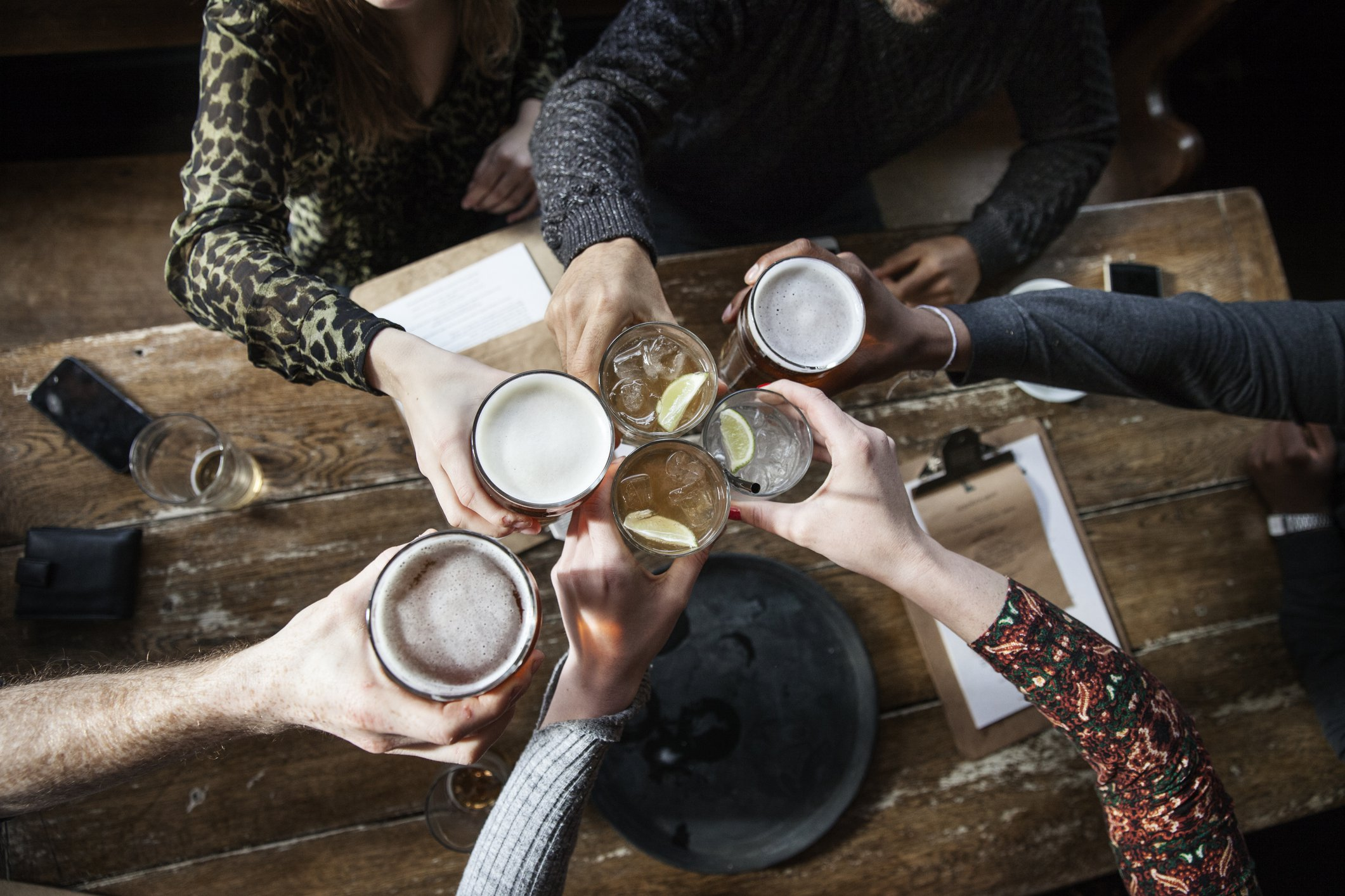 friends at a pub toasting, having a good time, birds view