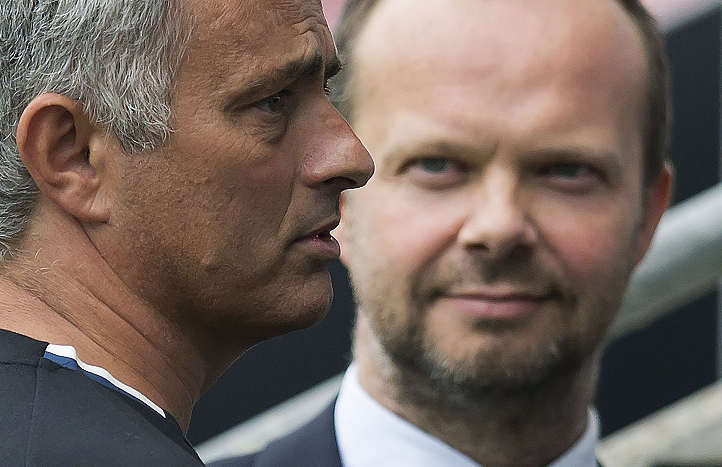 (FILES) In this file photo taken on July 16, 2016 Manchester United's executive vice-chairman Ed Woodward (R) listens as Manchester United's Portuguese manager Jose Mourinho talks with former Manchester United player Bobby Charlton (not pictured) following the pre-season friendly football match between Wigan Athletic and Manchester United at the DW stadium in Wigan, northwest England, on July 16, 2016. - Jose Mourinho on August 24, 2018 denied a rift with executive vice-chairman Ed Woodward despite growing speculation over the power structure at Manchester United. (Photo by JON SUPER / AFP) / RESTRICTED TO EDITORIAL USE. No use with unauthorized audio, video, data, fixture lists, club/league logos or 'live' services. Online in-match use limited to 75 images, no video emulation. No use in betting, games or single club/league/player publications. / JON SUPER/AFP/Getty Images