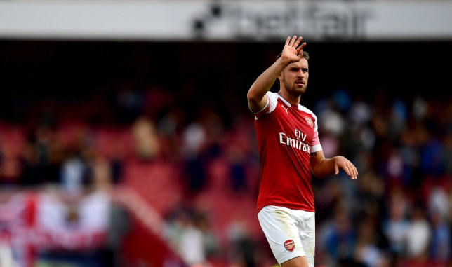 "Arsenal's Aaron Ramsey acknowledges the fans after the final whistle during the Premier League match at the Emirates Stadium, London. PRESS ASSOCIATION Photo. Picture date: Saturday August 25, 2018. See PA story SOCCER Arsenal. Photo credit should read: Victoria Jones/PA Wire. RESTRICTIONS: EDITORIAL USE ONLY No use with unauthorised audio, video, data, fixture lists, club/league logos or ""live"" services. Online in-match use limited to 120 images, no video emulation. No use in betting, games or single club/league/player publications."