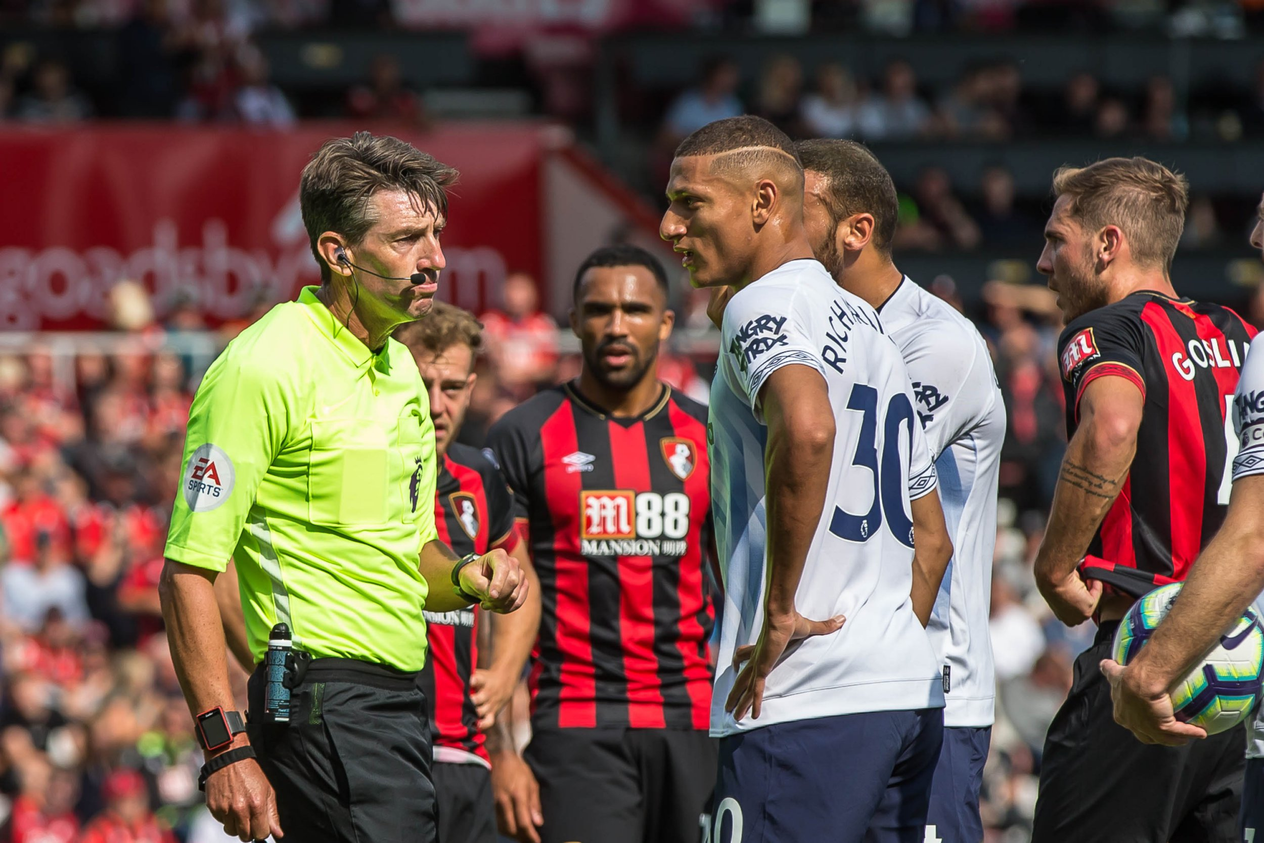 Lee Probert shows the red card to Richarlison(30) of Everton but the player is not happy with the decision during the Premier League match between AFC Bournemouth and Everton at the Vitality Stadium, Bournemouth, England on 25 August 2018. Photo by Simon Carlton.