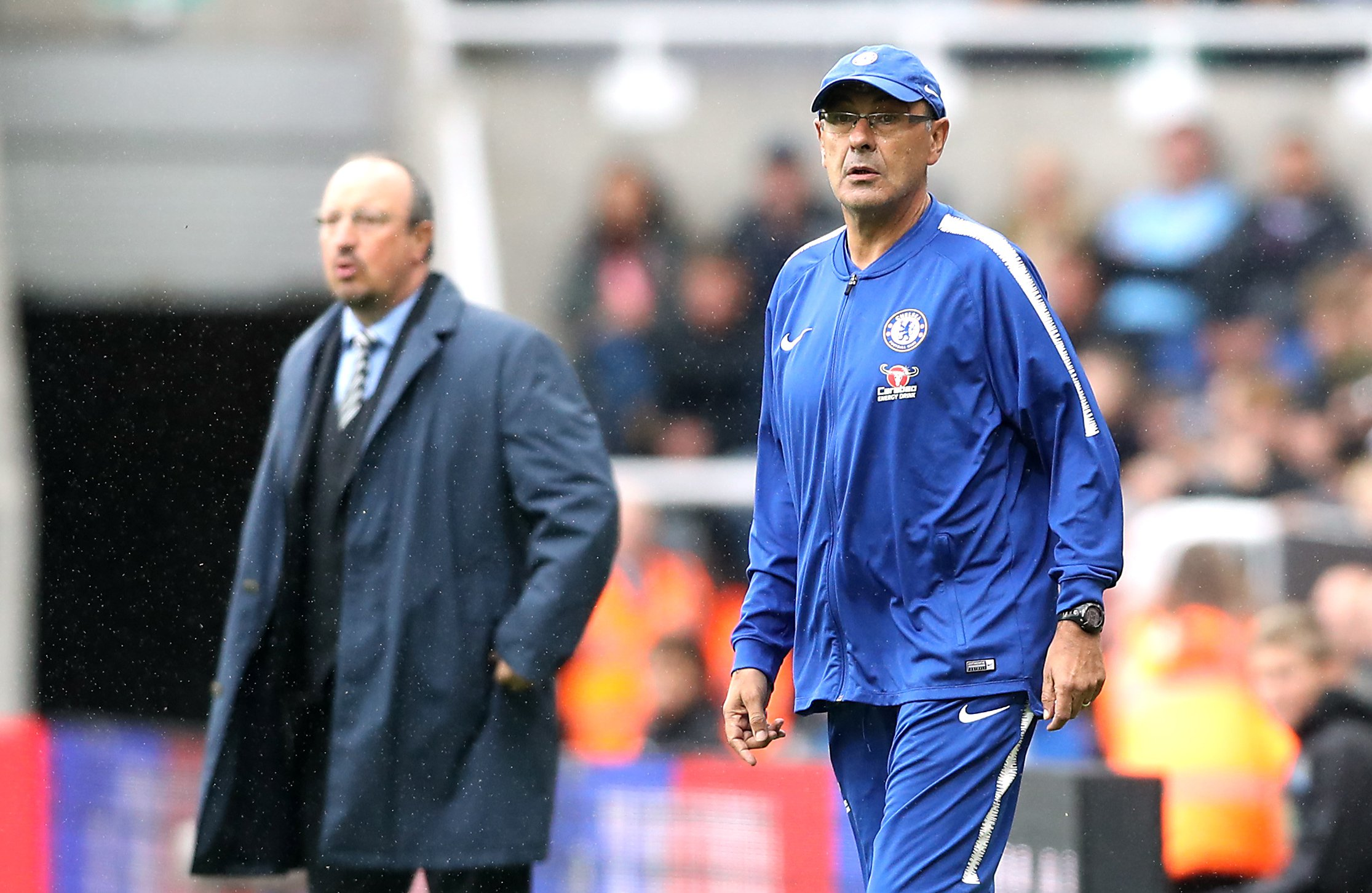 """Chelsea manager Maurizio Sarri (right) and Newcastle United manager Rafael Benitez during the Premier League match at St James' Park, Newcastle. PRESS ASSOCIATION Photo. Picture date: Sunday August 26, 2018. See PA story SOCCER Newcastle. Photo credit should read: Owen Humphreys/PA Wire. RESTRICTIONS: EDITORIAL USE ONLY No use with unauthorised audio, video, data, fixture lists, club/league logos or """"live"""" services. Online in-match use limited to 120 images, no video emulation. No use in betting, games or single club/league/player publications."""