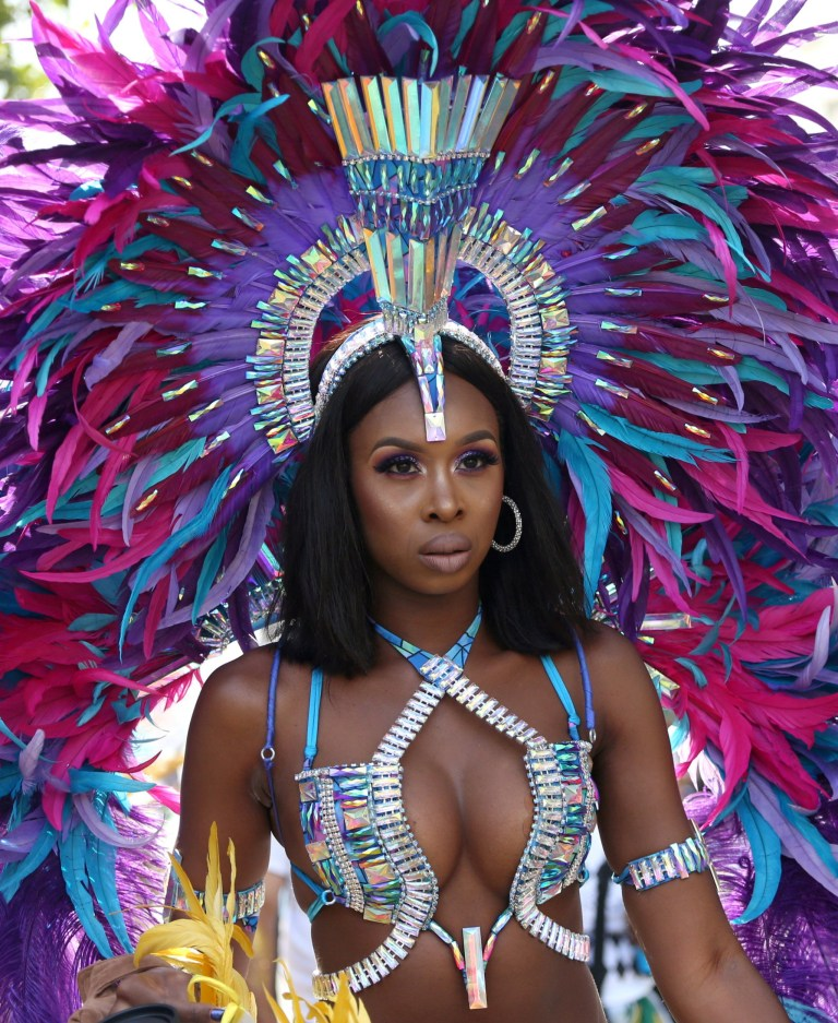 The spectacular costumes of the Notting Hill Carnival parade are on full display as the dancers make their way through London, August 27 2018.