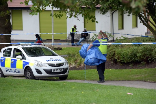 Pic by Michael Scott/Caters News - (PICTURED: A police cordon in Wandsworth Park, Birmingham next to the Wandsworth Wellbeing Centre where a 16-year-old boy was seriously stabbed and a 15-year-old girl was also hurt in the attack that happened around 6.40pm on Monday evening. Pic taken 28/08/2018) - A teenager is in a serious condition in hospital after being stabbed in a park. Paramedics were rushed to the York Road area of Handsworth Park in Birmingham yesterday evening at 6.40pm yesterday [MON]. The young boy was taken to hospital where he is still in a serious condition today [TUES]. A 15-year-old girl also suffered minor injuries. Police have launched an investigation and ask for anyone with information to contact them. Investigating officer Sgt Damian Forrest, from the Force CID team, said: I am asking for anyone with information on this attack to come forward and speak to us. Anything you know could really help our investigation while it is in the early stages. SEE CATERS COPY.
