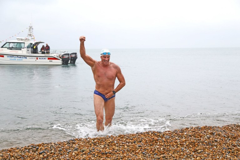"Lewis Pugh swims into Shakespeare Beach to complete his ""Long Swim"" from Land's End to Dover. PRESS ASSOCIATION Photo. Picture date: Wednesday August 29, 2018. Pugh will be the first person to swim the length of the English Channel wearing just a swimming cap, goggles and a pair of trunks. See PA story ENVIRONMENT Swim. Photo credit should read: Gareth Fuller/PA Wire"