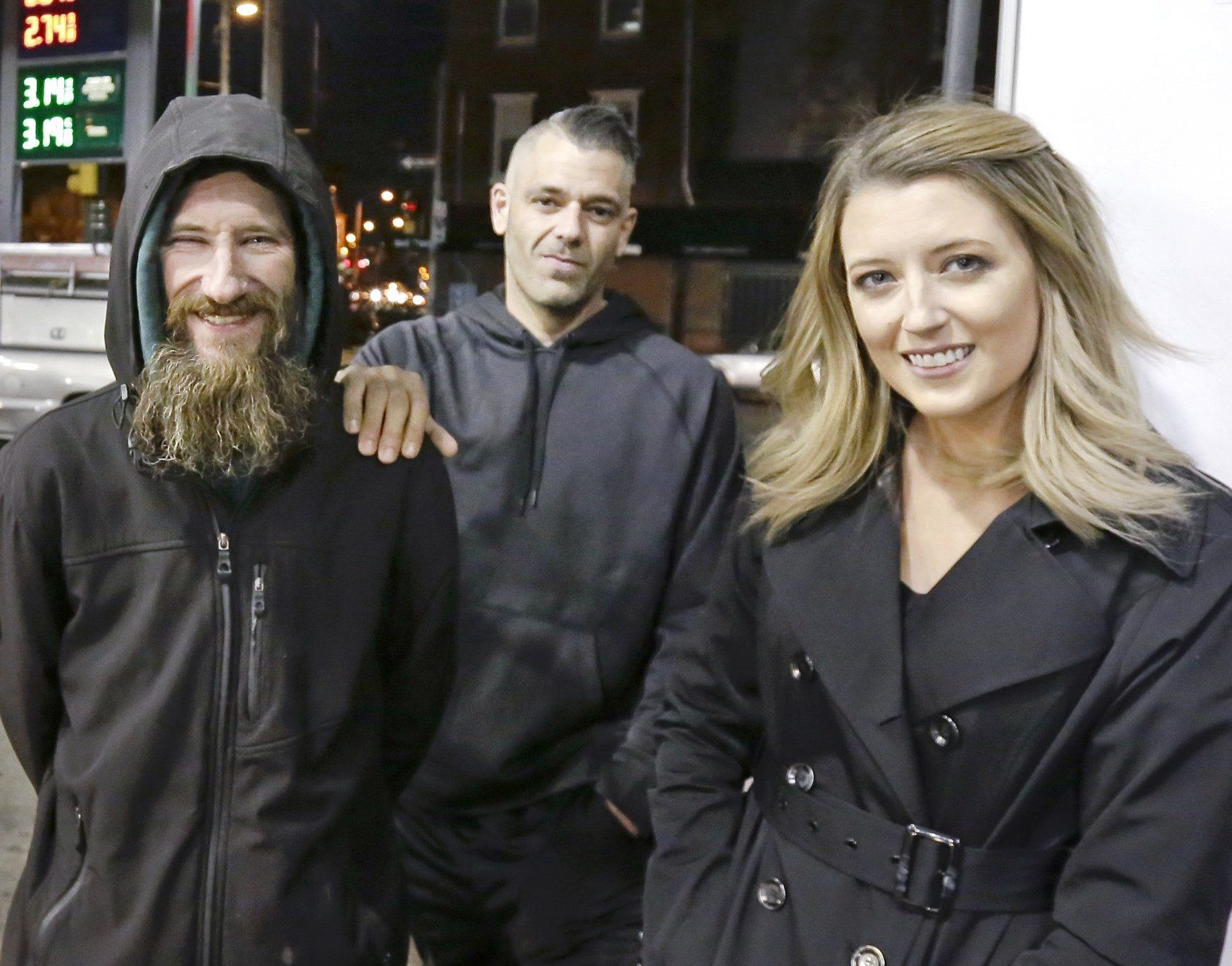 FILE ??? In this Nov. 17, 2017, file photo, Johnny Bobbitt Jr., left, Kate McClure, right, and McClure's boyfriend Mark D'Amico pose at a Citgo station in Philadelphia. Bobbitt, a homeless man whose selfless act of using his last $20 to fill the gas tank of a stranded motorist in Philadelphia drew worldwide attention, filed suit against D'Amico and McClure, the couple who led a $400,000 GoFundMe fundraising campaign to help him, contending the couple mismanaged donations and committed fraud by taking contributed money for themselves. A hearing is scheduled Thursday, Aug. 30, 2018. (Elizabeth Robertson/The Philadelphia Inquirer via AP)