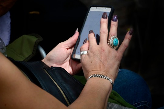 SANTA FE, NM - AUGUST 19, 2017: A woman uses her Samsung smartphone in Santa Fe, New Mexico. (Photo by Robert Alexander/Getty Images)