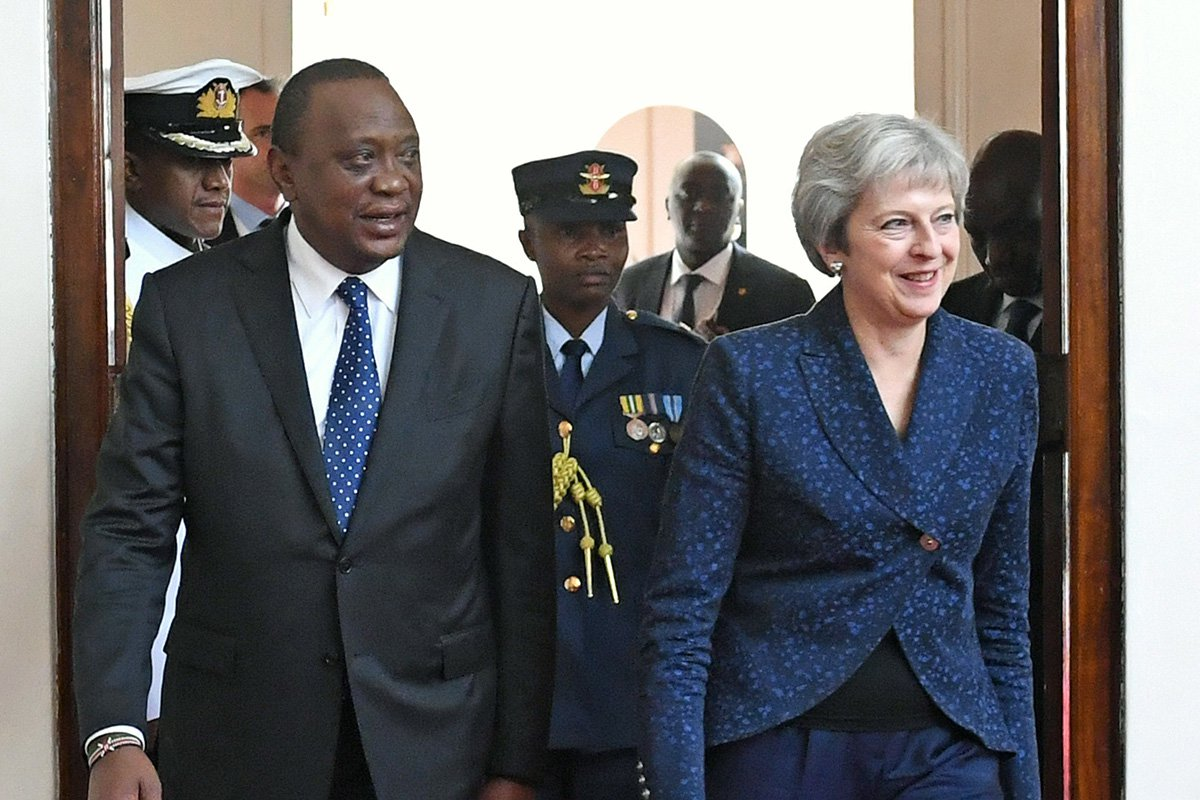 Prime Minister Theresa May with the President of Kenya Uhuru Kenyatta at the State House in Nairobi, on the third day of her visit to Africa. ESS ASSOCIATION Photo. Picture date: Thursday August 30, 2018. See PA story POLITICS Africa. Photo credit should read: Stefan Rousseau/PA Wire