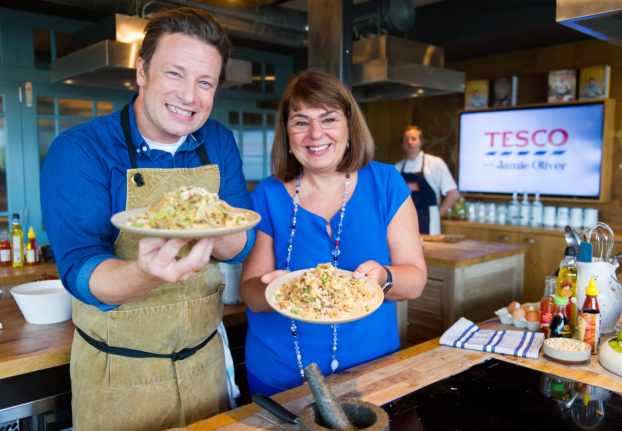 Jamie Oliver, pictured with Chief Customer Officer for Tesco Alessandra Bellini, has announced his new partnership with Tesco (Picture: Tesco)