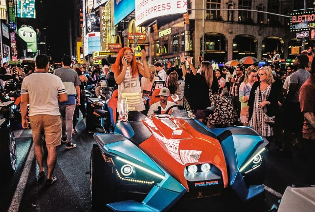 Slingshots parade the streets around Times Square (Picture: Hannah Berry George)