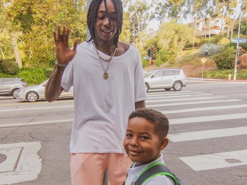 Wiz Khalifa defends young son riding the bus to school: 'He wanted to go with his friends'