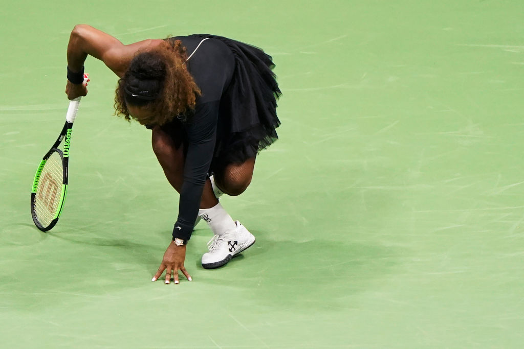 Serena Williams to monitor ankle after injury scare in crushing Venus win