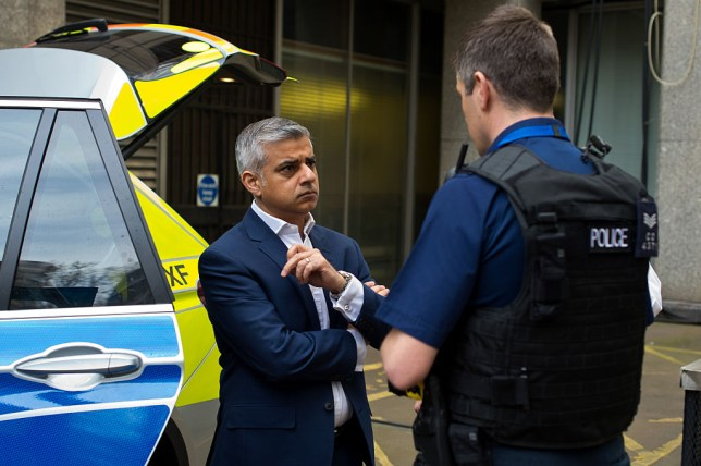 LONDON, ENGLAND - APRIL 21: Labour Mayoral Candidate Sadiq Khan speaks with members of the Metropolitan Police Armed Response Unit during a visit to Scotland Yard on April 21, 2016 in London, England. Sadiq Khan is currently one of the main contenders running against Conservative candidate Zac Goldsmith as both parties campaign ahead of the election on May 5th. (Photo by Ben Pruchnie/Getty Images)