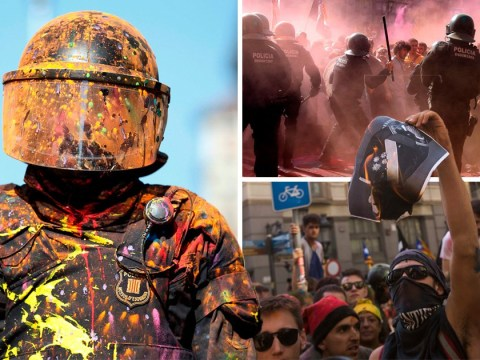 Catalan separatists hurl paint at police amid angry clashes in Barcelona