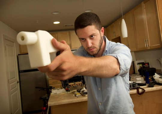 Cody Wilson shows the first completely 3D-printed handgun, The Liberator, at his home in Austin, Texas on Friday May 10, 2013. (Jay Janner/Austin American-State/TNS)