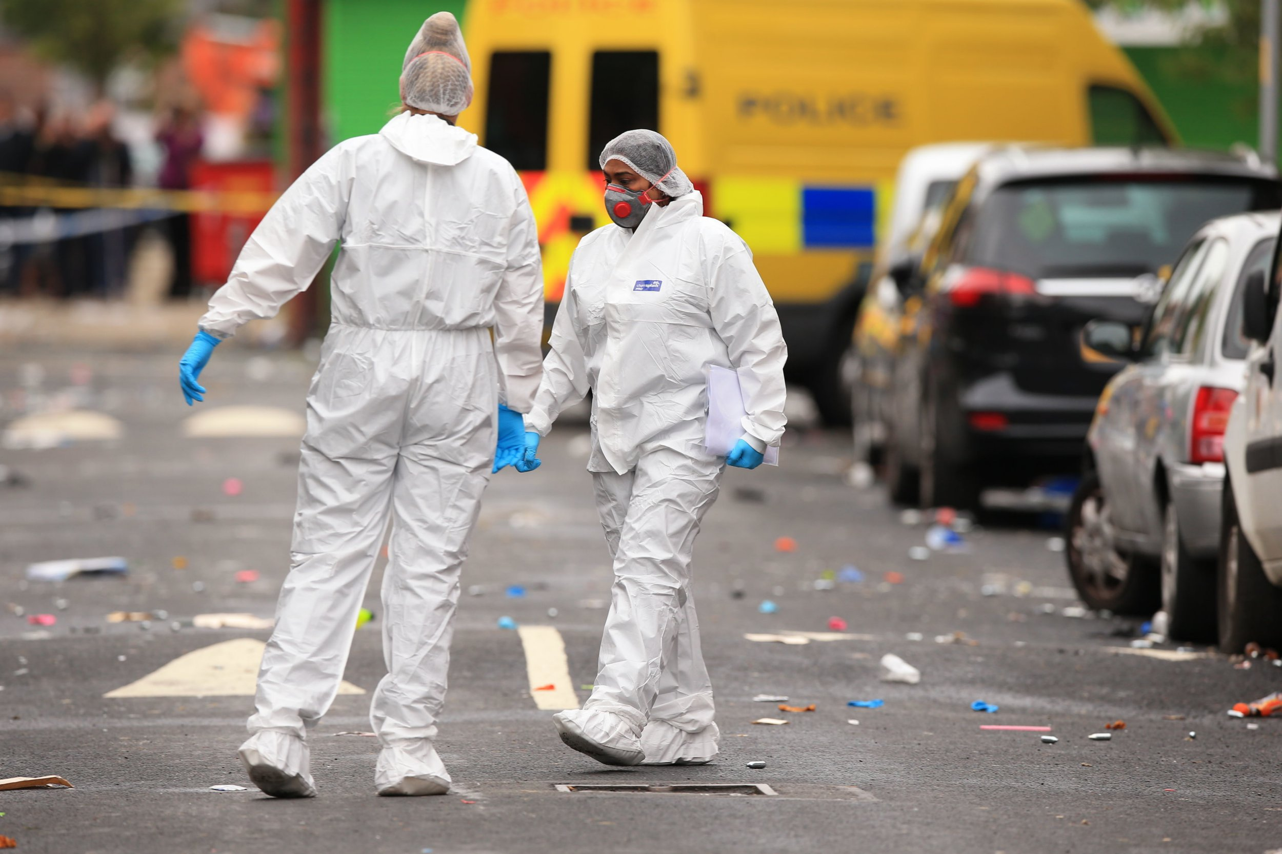 Forensics officers at the scene in Claremont Road, Moss Side, Manchester, where several people have been injured after a shooting. PRESS ASSOCIATION Photo. Picture date: Sunday August 12, 2018. Armed officers were called at 2.30am on Sunday following the celebrations of the Caribbean Carnival. See PA story POLICE Shooting. Photo credit should read: Peter Byrne/PA Wire