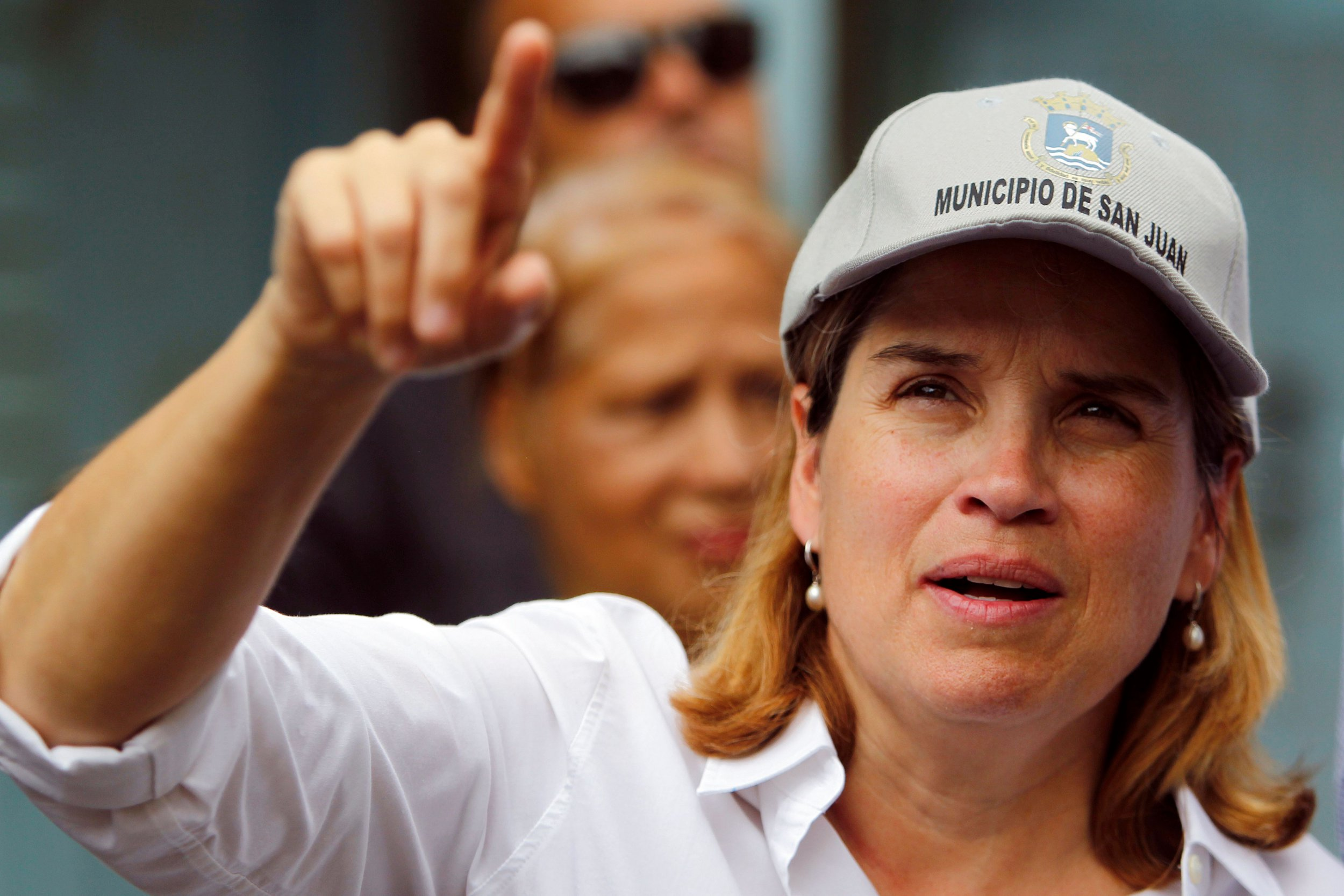 """(FILES) In this file photo taken on October 27, 2017 The Mayor of San Juan, Carmen Yulin Cruz points as she visits the Playita community with US Senator Bernie Sanders in San Juan, Puerto Rico. - US President Donald Trump's administration killed Puerto Ricans through """"neglect,"""" the mayor of the island's capital, Yulin Cruz, said on August 29, 2018, a day after the official death toll for Hurricane Maria was raised to nearly 3,000. (Photo by Ricardo ARDUENGO / AFP)RICARDO ARDUENGO/AFP/Getty Images"""