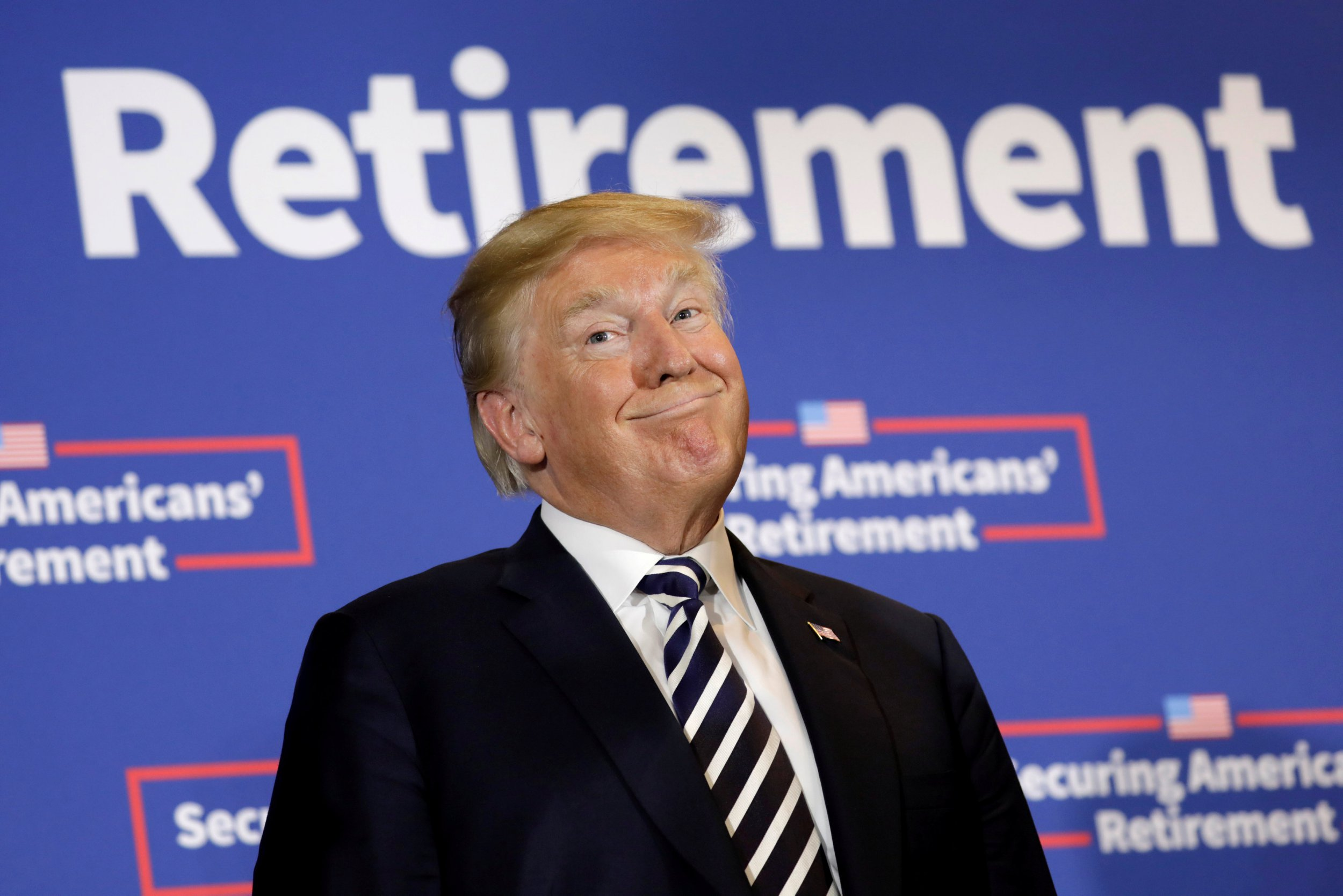 U.S. President Donald Trump smiles before signing an executive order on strengthening retirement security in America at Harris Conference Center in Charlotte, NC, U.S., August 31, 2018. REUTERS/Yuri Gripas TPX IMAGES OF THE DAY