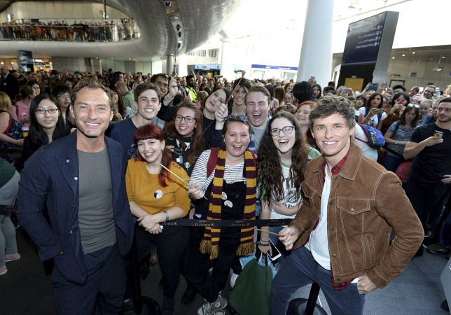 LONDON, ENGLAND - SEPTEMBER 01: Eddie Redmayne (R) and Jude Law (L), stars of Fantastic Beasts: The Crimes Of Grindelwald, surprise fans at platform 9 3/4 during 'Back to Hogwarts' day celebration at Kings Cross Station on September 1, 2018 in London, England. (Photo by Jeff Spicer/Getty Images for Warner Bros)