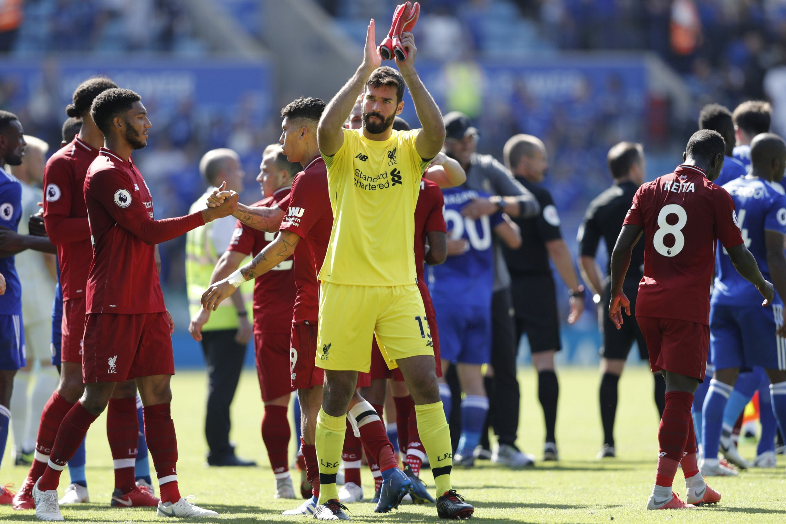 Liverpool's Brazilian goalkeeper Alisson Becker gestures after the final whistle during the English Premier League football match between Leicester City and Liverpool at King Power Stadium in Leicester, central England on September 1, 2018. (Photo by Adrian DENNIS / AFP) / RESTRICTED TO EDITORIAL USE. No use with unauthorized audio, video, data, fixture lists, club/league logos or 'live' services. Online in-match use limited to 120 images. An additional 40 images may be used in extra time. No video emulation. Social media in-match use limited to 120 images. An additional 40 images may be used in extra time. No use in betting publications, games or single club/league/player publications. / ADRIAN DENNIS/AFP/Getty Images