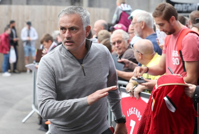 """Manchester United manager Jose Mourinho signs autographs for fans before the Premier League match at Turf Moor, Burnley. PRESS ASSOCIATION Photo. Picture date: Sunday September 2, 2018. See PA story SOCCER Burnley. Photo credit should read: Martin Rickett/PA Wire. RESTRICTIONS: EDITORIAL USE ONLY No use with unauthorised audio, video, data, fixture lists, club/league logos or """"live"""" services. Online in-match use limited to 120 images, no video emulation. No use in betting, games or single club/league/player publications."""