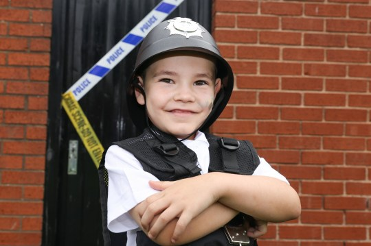 MERCURY PRESS. Wirral, UK. 4/9/18. Pictured: Alfie Minnis, 5, in his police outfit. This is the heartwarming moment cops took time out of their day to go to a five-year-old's birthday party as the little lad longs for the day he can be a policeman. Alfie Minnis, who has dreamed of being in the force since he was two, got the best birthday surprise ever when two Merseyside Police constables turned up at his party on Sunday. The schoolboy got to spend an hour with the cops who sang Happy Birthday, brought him gifts and took him and his friends for a ride in their jeep. SEE MERCURY COPY