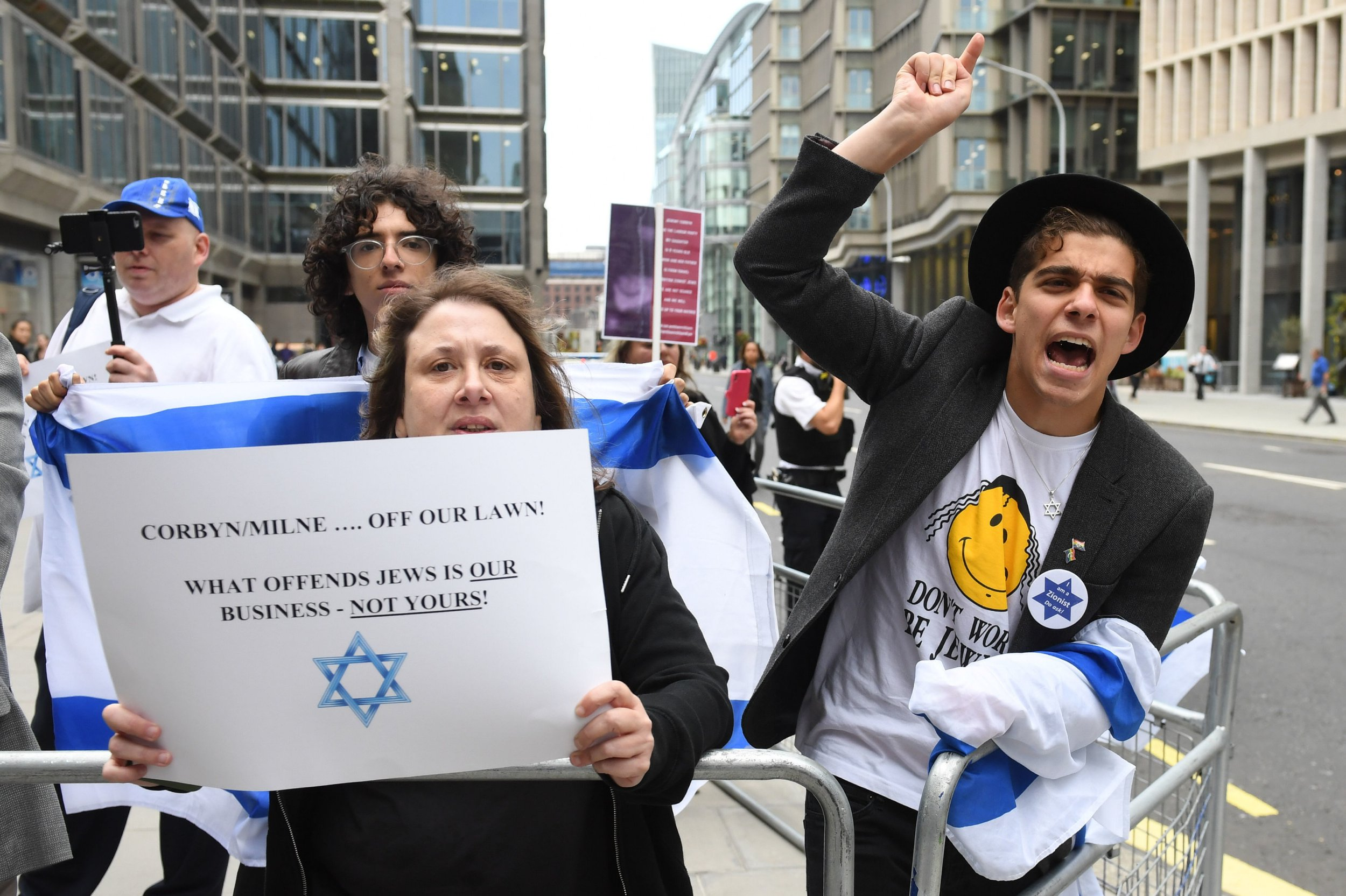 Activists outside a meeting of the Labour National Executive Committee in London which is expected to decide on whether to adopt the International Holocaust Remembrance Alliance (IHRA) definition of anti-Semitism and its examples, which has been the subject of a bitter row within the party over recent months. PRESS ASSOCIATION Photo. Picture date: Tuesday September 4, 2018. See PA story POLITICS Labour. Photo credit should read: Stefan Rousseau/PA Wire