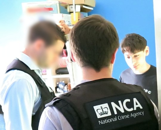 HOLD for STORY. Undated picture issued by the National Crime Agency of the arrest of George Duke-Cohan, 19, who has admitted making bomb threats to thousands of schools and a United Airlines flight travelling from the UK to San Francisco last month. PRESS ASSOCIATION Photo. Issue date: Tuesday September 4, 2018. He pleaded guilty at Luton Magistrates Court to three counts of making hoax bomb threats following an investigation by the National Crime Agency and has been remanded in custody to Luton Crown Court. See PA story POLICE Hoax. Photo credit should read: National Crime Agency/PA Wire NOTE TO EDITORS: This handout photo may only be used in for editorial reporting purposes for the contemporaneous illustration of events, things or the people in the image or facts mentioned in the caption. Reuse of the picture may require further permission from the copyright holder.