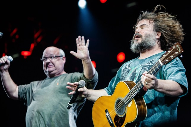 Kyle Gass and Jack Black performing as Tenacious D at the Roskilde Festival in Denmark.