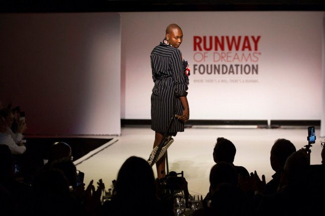 The Runway of Dreams collection is modeled Wednesday, Sept. 5, 2018, during Fashion Week in New York. The runway show featured models with disabilities wearing adaptive clothing for children and adults.(AP Photo/Kevin Hagen).