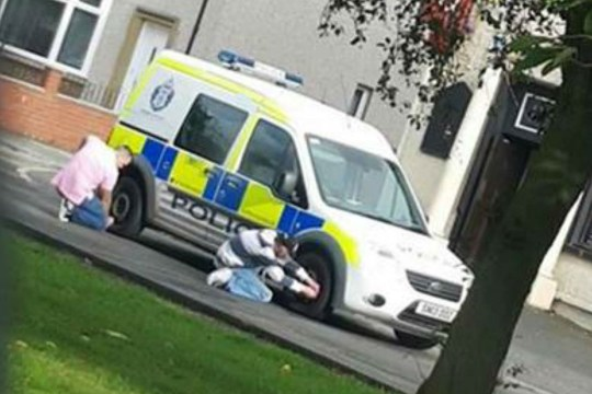 SHOCKING pictures captured the moment two middle-aged men letting down a police van?s tyres - while officers were in the middle of an arrest.The disturbing photograph captured the duo in the act while police were attending to a call out in Grangemouth, Falkirk on Sunday.It shows one man kneeling down on the ground letting air out of the back tyre, while another male is busy deflating the tyre at the front.The image, believed to be taken by a passing motorist, was shared on social media where it circulated around various Facebook groups.