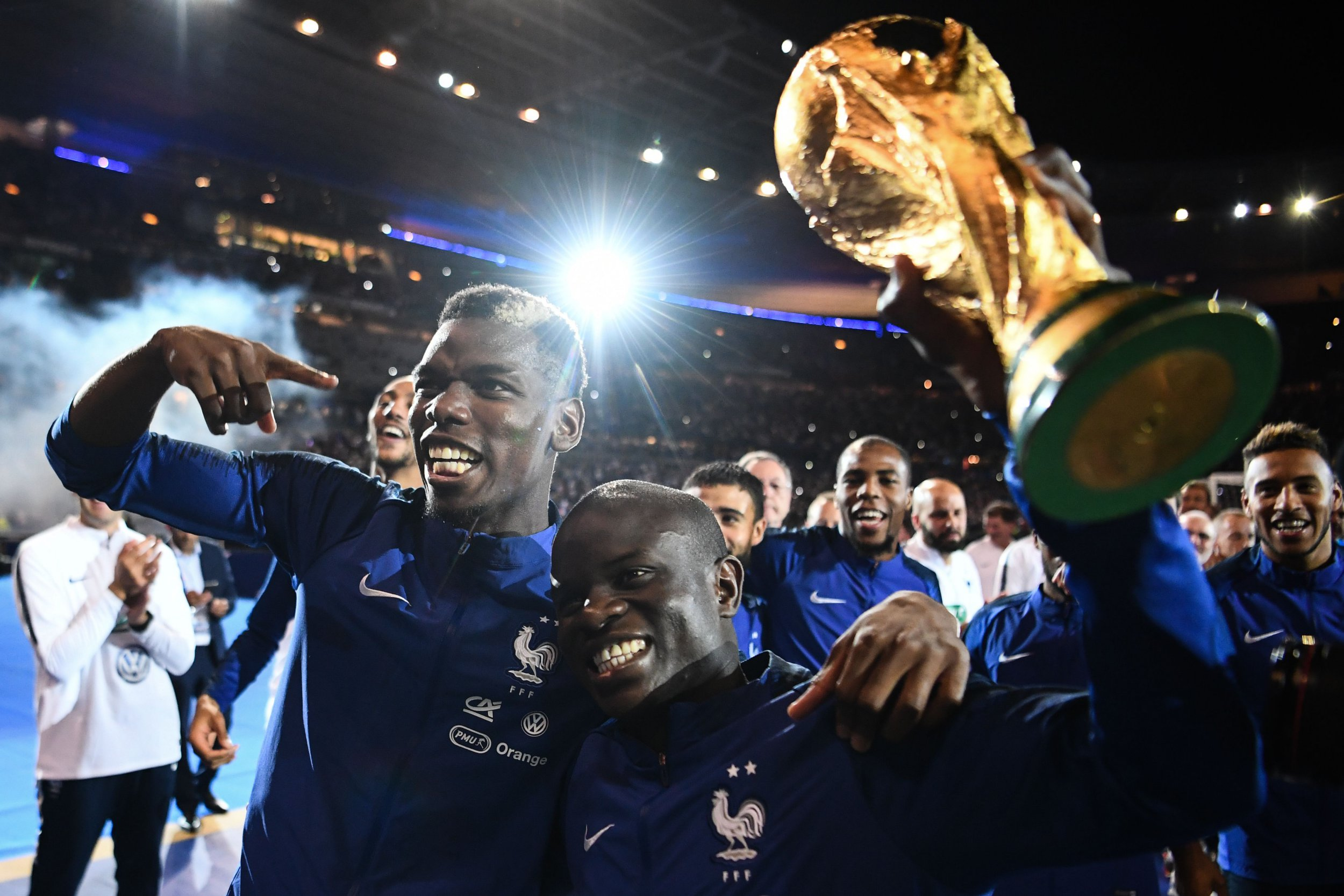 France's midfielder Paul Pogba (L) and France's defender N'golo Kante hold the 2018 World Cup trophy as they celebrate during a ceremony for the victory of the 2018 World Cup at the end of the UEFA Nations League football match between France and Netherlands at the Stade de France stadium, in Saint-Denis, northern of Paris, on September 9, 2018. (Photo by FRANCK FIFE / AFP)FRANCK FIFE/AFP/Getty Images