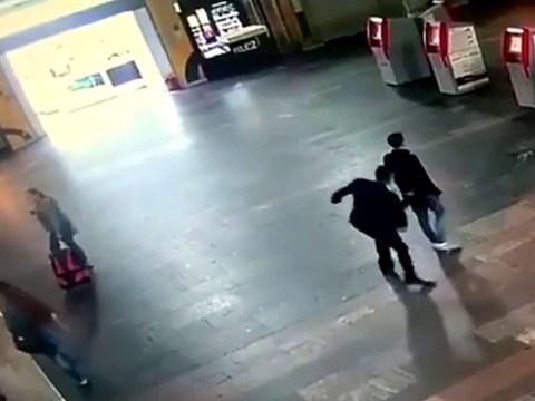 Man filmed randomly stabbing people at busy railway station