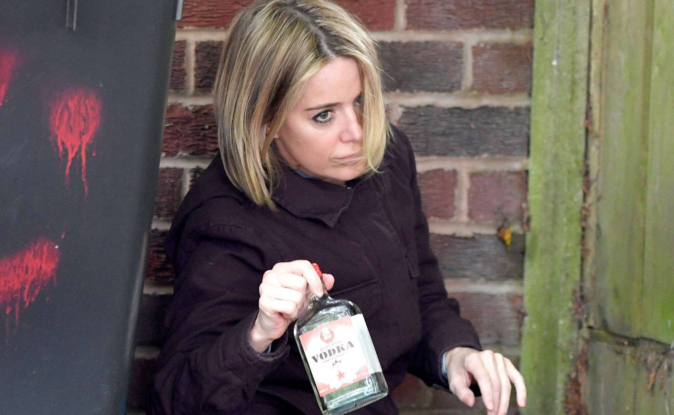 Pics Paul Cousans/Zenpix Ltd....... Corrie... Tough times for Abi Franklin(Sally Carman) As she is desperate to see her twins Lexi and Charlie.(played by real life twins Jasmine and Jacob Fish) who have been adopted. Downing a bottle of Vodka she heads off to try and catch a glimpse of her siblings as they arrive home with their adoptive mum. Hoping that they would look miserable she realised their lives had changed dramatically When she sees her kids enjoying themselves. Abi is left in tears as she realises how bad a mother she really is. Abi can only stand and watch as her kids arrive home